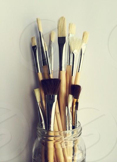 Paintbrushes against a white backdrop.  photo