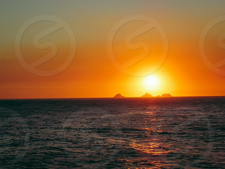 rippling waters during sunset photo