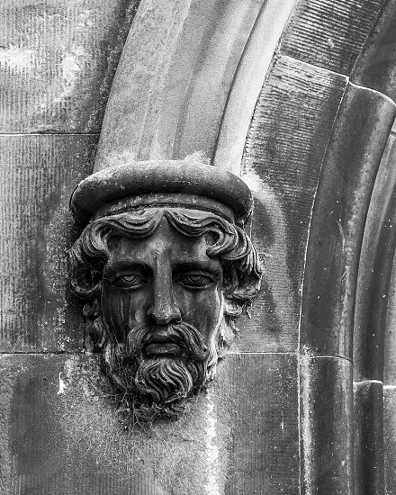 Man's face carved in stone on Scottish church.  Black and White photo