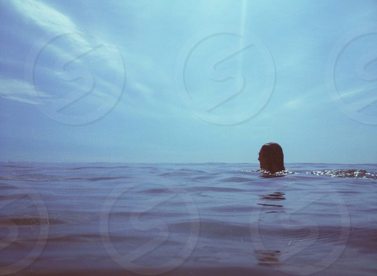 person swimming in water photo