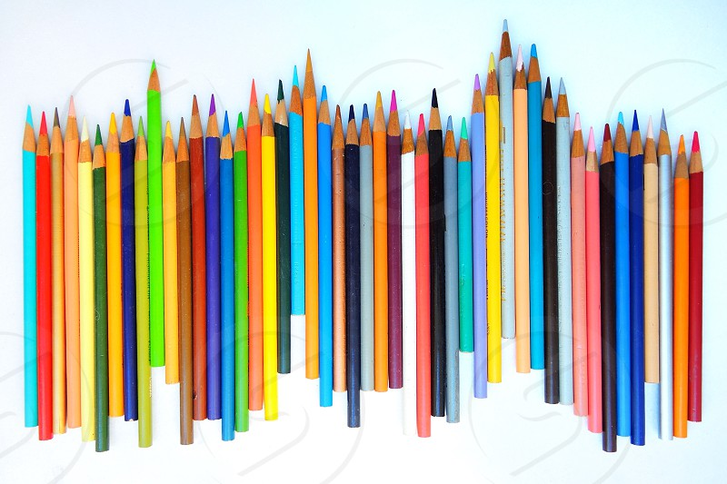 red blue and white color pencils photo