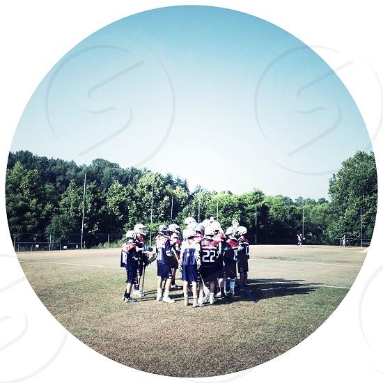 lacrosee team in a huddle photo