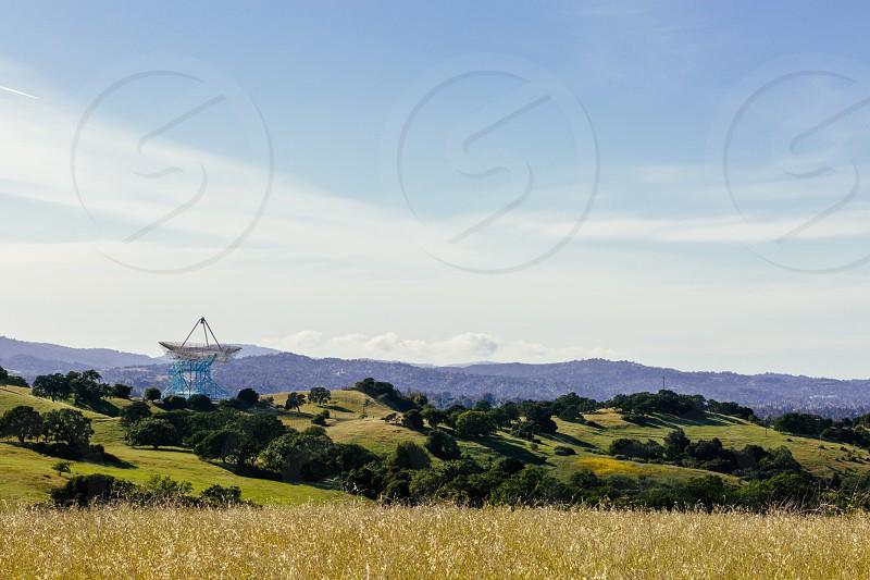 satellite dish near green trees photo