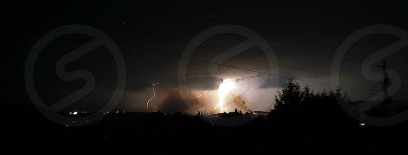 out along side of wenatchee wa lightning catching the hills on fire  photo