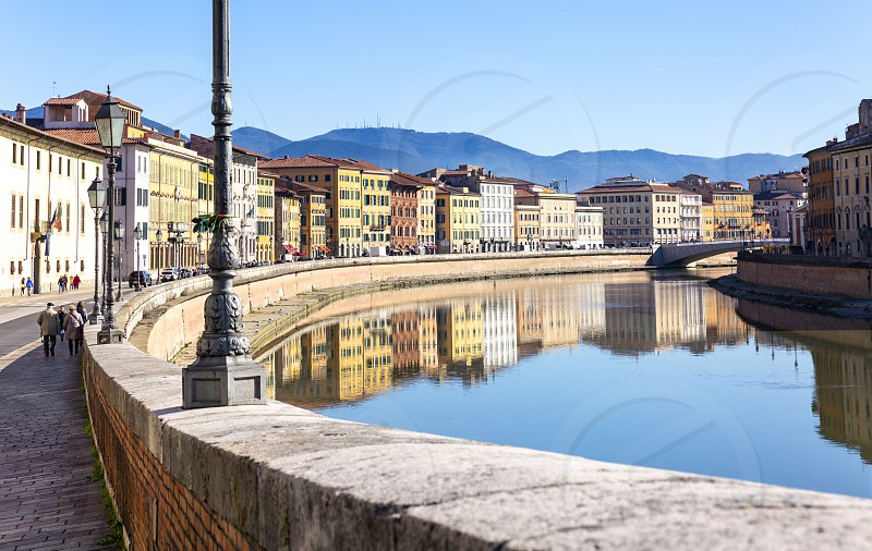 Pisa Italy 12/02/2018: Urban landscape of the city of Pisa crossed by the river Arno photo taken during a holiday photo