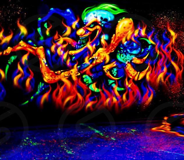 Blacklight clown scary spook house brilliant bright colorful photo