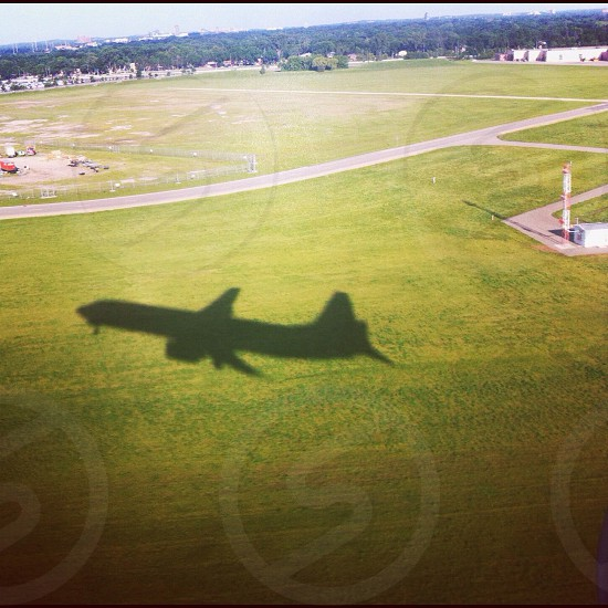 air plane shadow on green grass photo