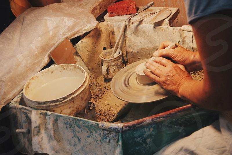 Pottery hands clay crafts work working handmade studio workshop earthenware crockery photo