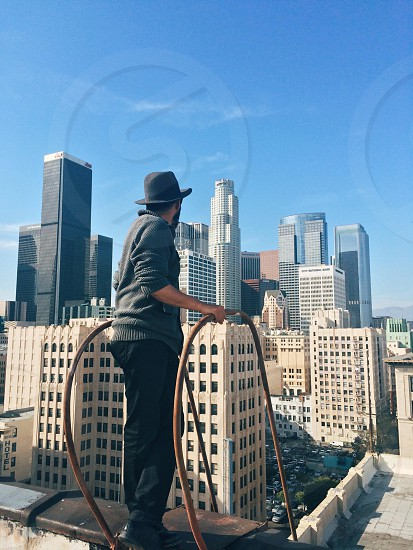 man standing on edge of building portrait photography photo