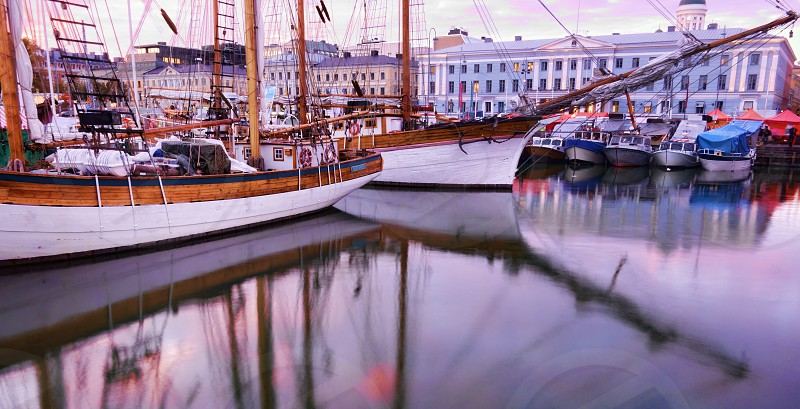 Helsinki Market Square and old sailing boats in  the sunset light during annual Baltic Herring Fair in the beginning of October.  photo
