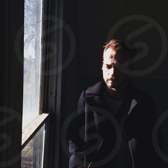 men's black collared coat photo