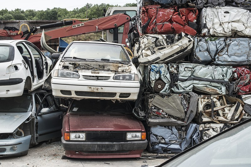 Baled scrap cars in depot for old cars.  photo