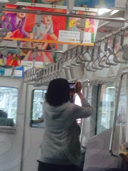 woman in train standing photo
