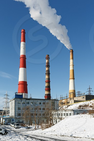 PETROPAVLOVSK-KAMCHATSKY KAMCHATKA RUSSIA - NOVEMBER 15 2014: View on building Kamchatka CHP-1 with smoking pipes (JSC Kamchatskenergo RAO Energy System of East). Russia Far East Kamchatka. photo
