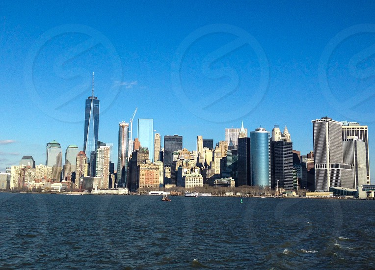 NYC Freedom Tower Skyline Statin Island Fairy Big city lights blue skies the big apple travel adventure  photo