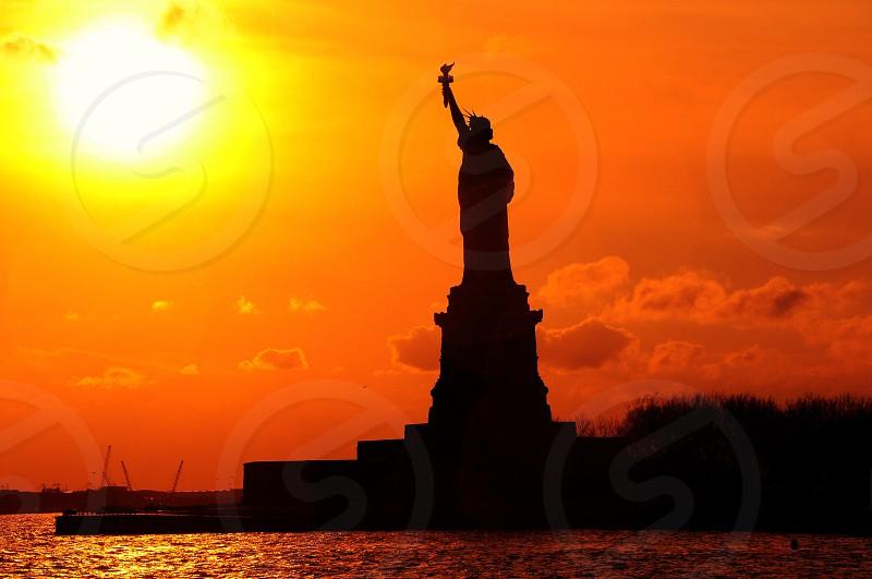 statue of liberty on sunset panoramic photography photo