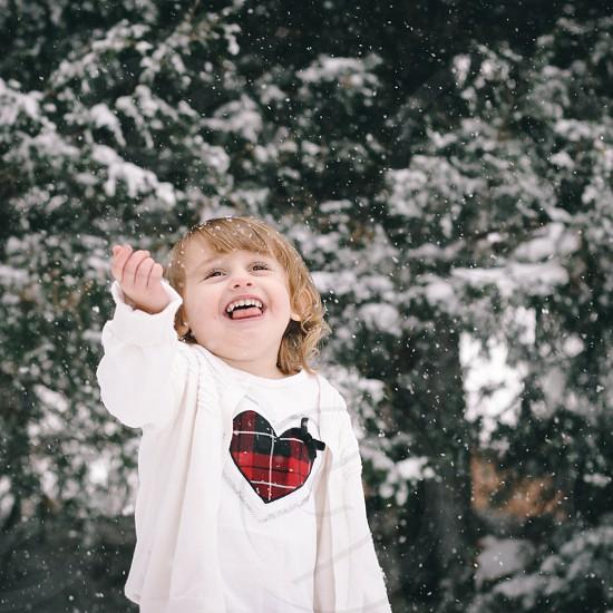 Reaching for snowflakes photo