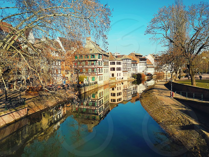 Traditional half-timbered houses on picturesque canals in La Petite France the medieval fairytale town of Strasbourg UNESCO World Heritage Site Alsace France. photo