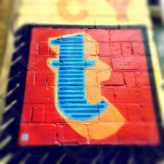 Letter T. Detail of street art by artist Ben Eine in Shoreditch London England.  photo