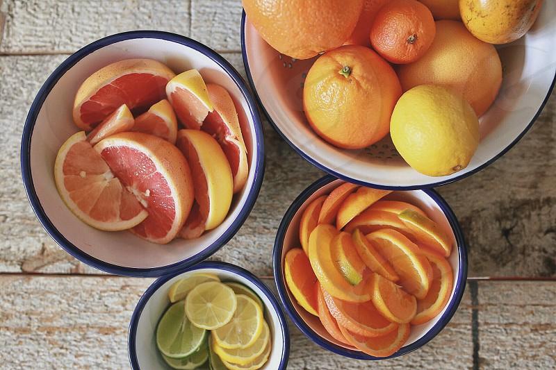 sliced fruit on bowl photo