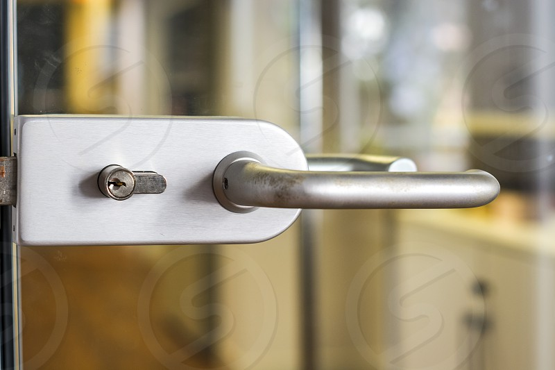 An abstract detail of a contemporary door handle for a glass door photo