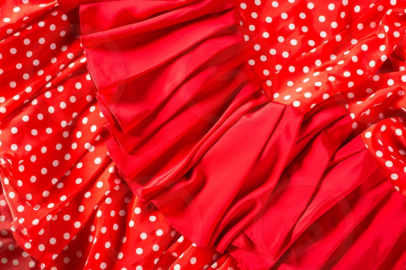 Flamenco dancer red dress with spots macro detail typical from Spain photo