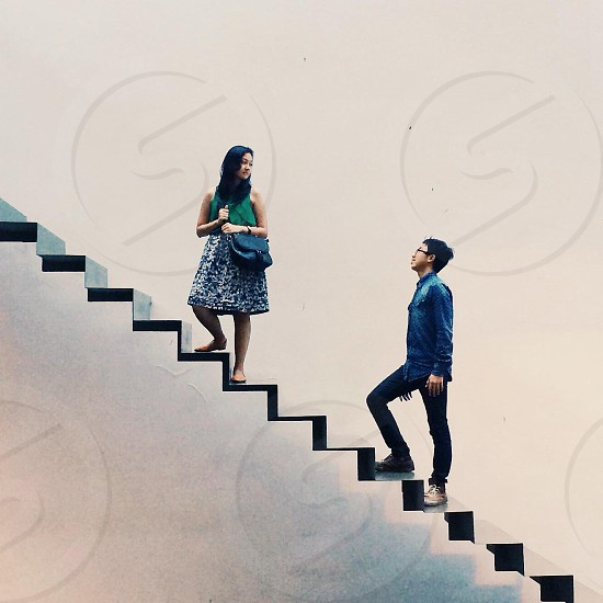 man and woman walking on stairs photo