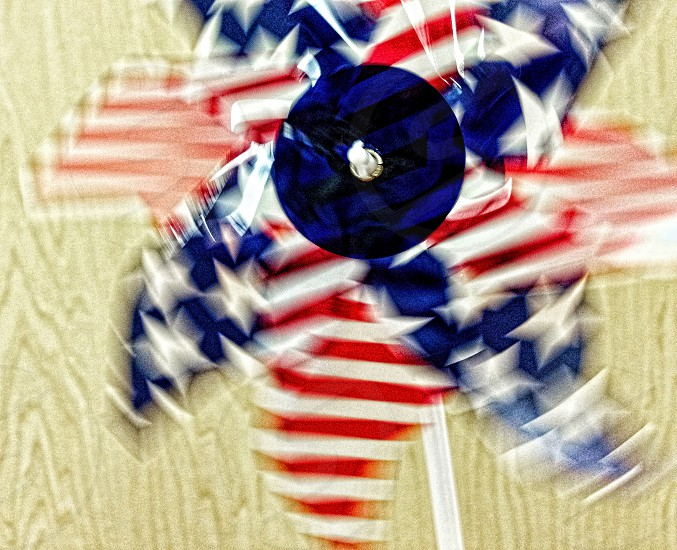 Spinning red white and blue pinwheel for fourth of July photo