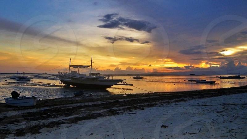 Beautiful sunset by the beach photo