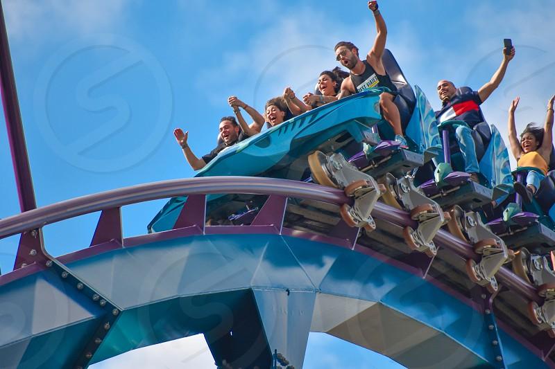 Orlando Florida . February 17  2019  People enjoying Mako Rollercoaster on lightblue cloudy sky background in International Drive area (7) photo