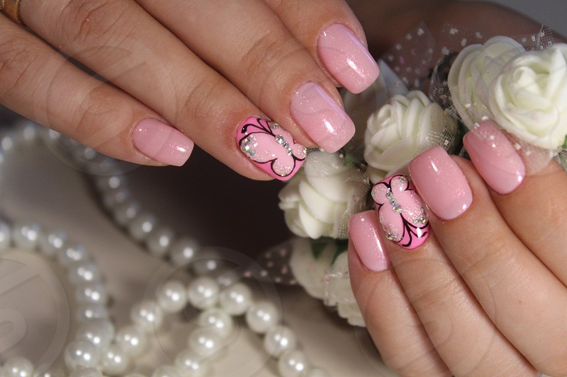 Manicure nail design with a butterfly pattern photo