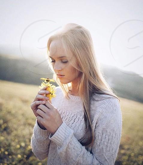 Sunset woman flower girl meadow sunrise summer love spring cute sun tan springtime sweater summertime relaxing mountain  photo