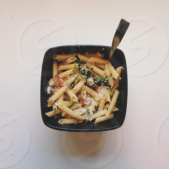 penna pasta meal in black rectangular bowl photo