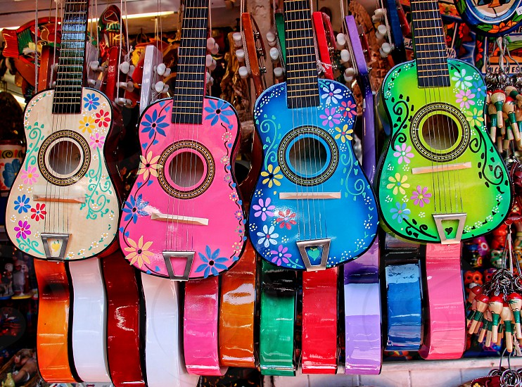 Mexican musical instruments ukuleles and guitars hand from a cart in a street market photo