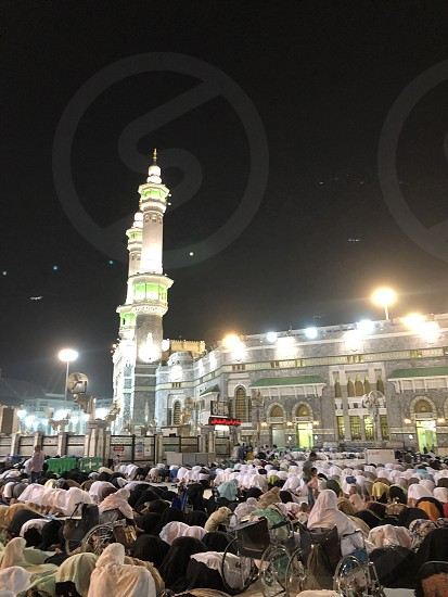 Mecca. Muslim pilgrims during prayer. Among the pilgrims are women in a wheelchair. photo