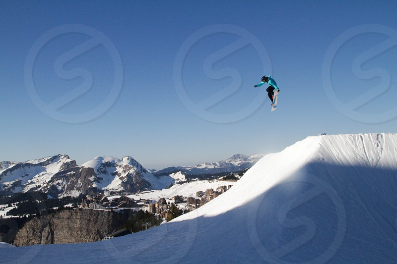 Mountain snow ski people lift pist sky cloud avoriaz jump trick photo