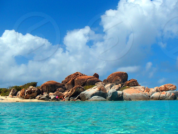 blue ocean and island with rock with cloudy blue sky photo