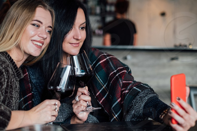 Women with glasses red wine photo