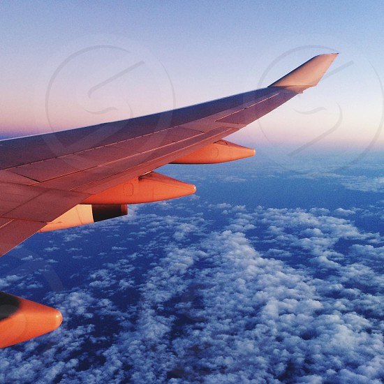 airplane wing over clouds photo