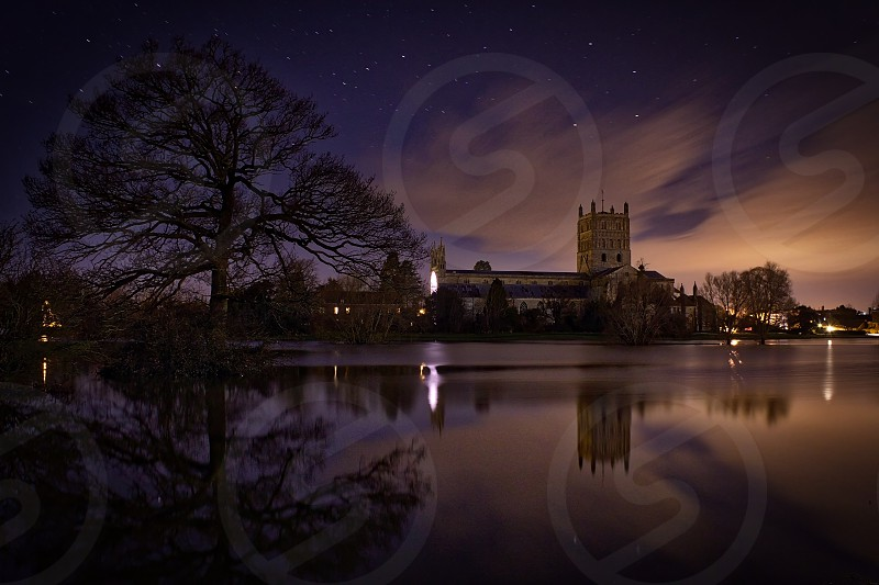 Tewkesbury Abbey reflected in flood water photo