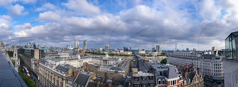 Outdoor day colour landscape horizontal panoramic Somerset House aerial Radio Rooftop Bar ME Hotel London UK England Great Britain capital city urban central Architecture buildings view vista scenic rooftops travel tourism tourist wanderlust leisure Strand street road traffic busy sky clouds overcast dark stormy skyscrapers skyline glass metal engineering photo