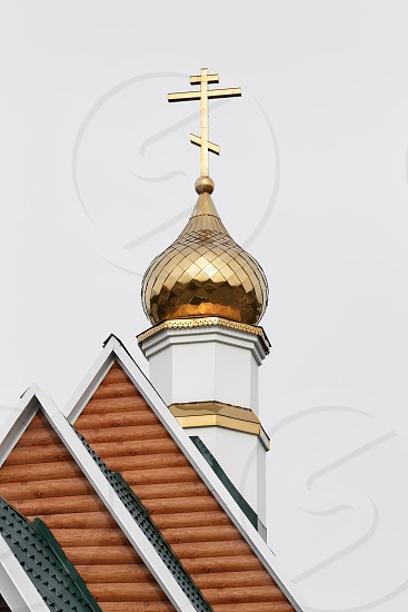 PETROPAVLOVSK-KAMCHATSKY KAMCHATKA PENINSULA RUSSIA - SEP 3 2017: Dome with an Orthodox cross on roof of Temple in Honor of Saint Sergius of Radonezh of Kamchatka Diocese of Russian Orthodox Church photo