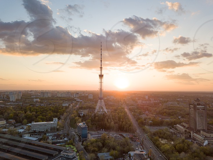 view of the city of Kiev with Dorogozhychi distric with a TV tower on sunset Ukraine. Drone photo photo