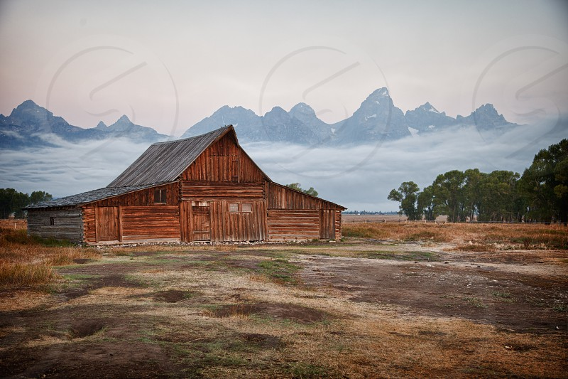 Empty barn with mountains in backdrop photo