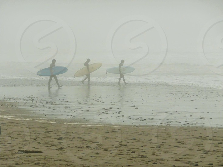 Surfers heading out into the mist La Push WA photo
