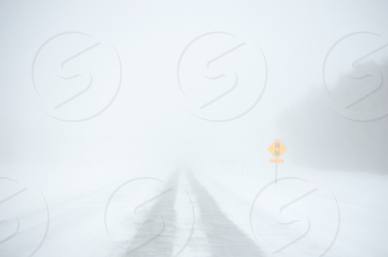 snowy road with tire marks photo