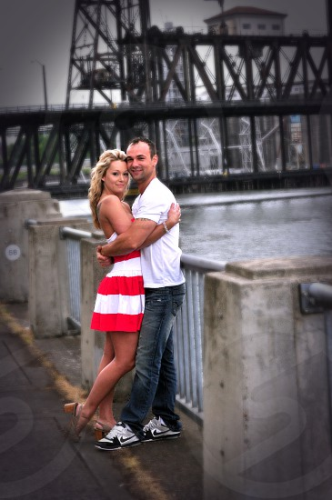 man and woman standing beside railings  photo