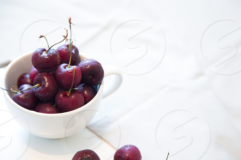 cherries in white cup photo