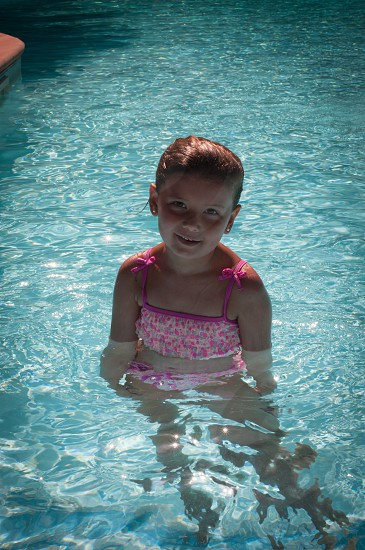Posing pool girl swimming water ripple tan stars sparkle photo