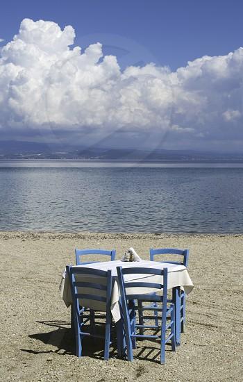 Chair in greek taverna on a beach photo